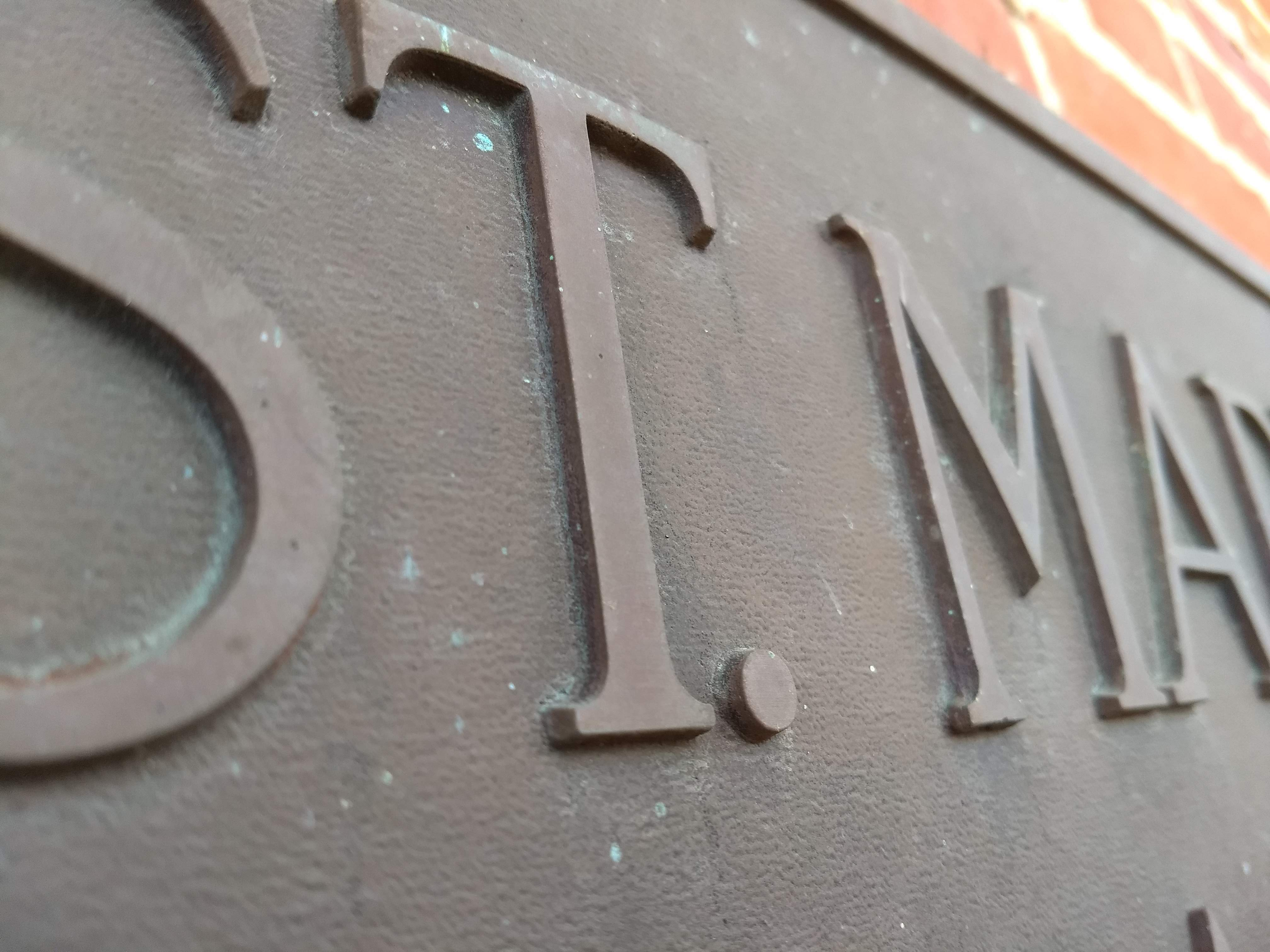 Close up detail of the St. Mary's Hall plaque.
