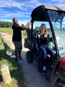 Two students, Isaac Page and Afton Hauer, are hard at work collecting compost in the compost cruiser!