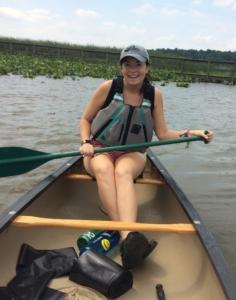 A photo of Meghan canoeing at Jug Bay Wetlands Sanctuary