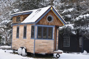 SMCM tiny house covered in snow
