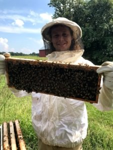 Student holding a bee hive insert