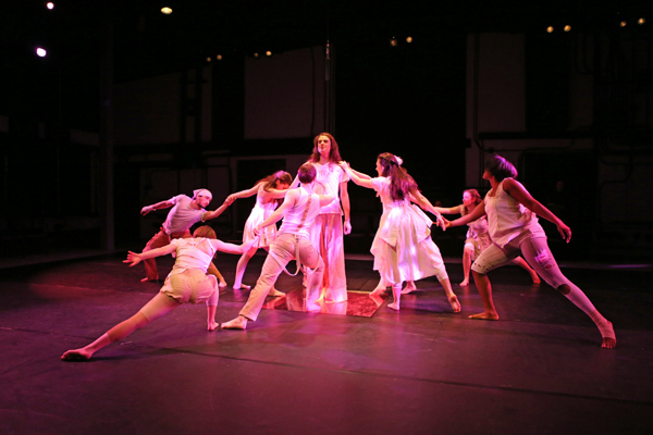 a student dance team performing on a stage.