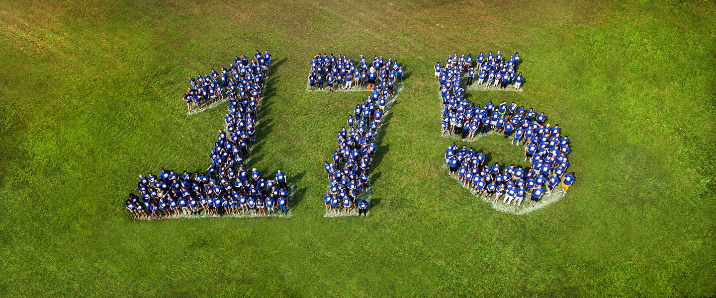 Aerial shot of 300 students forming the number 175 in honor of our anniversary
