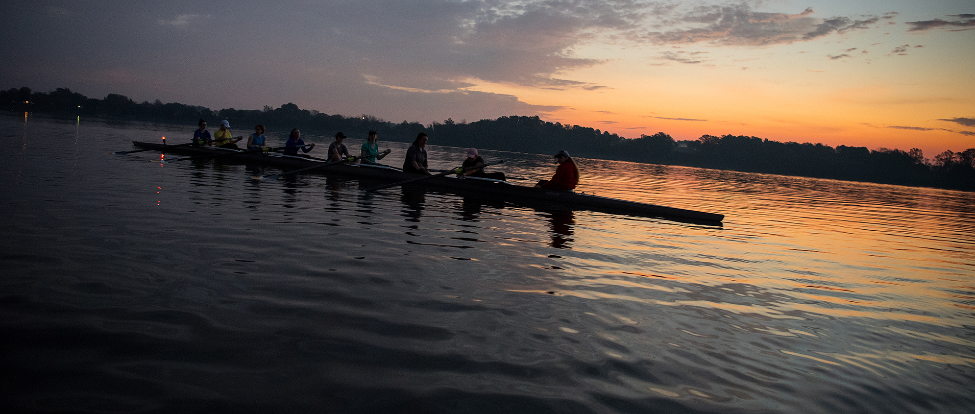 Crew Team Rowing on the St. Mary's River at Sunrise.