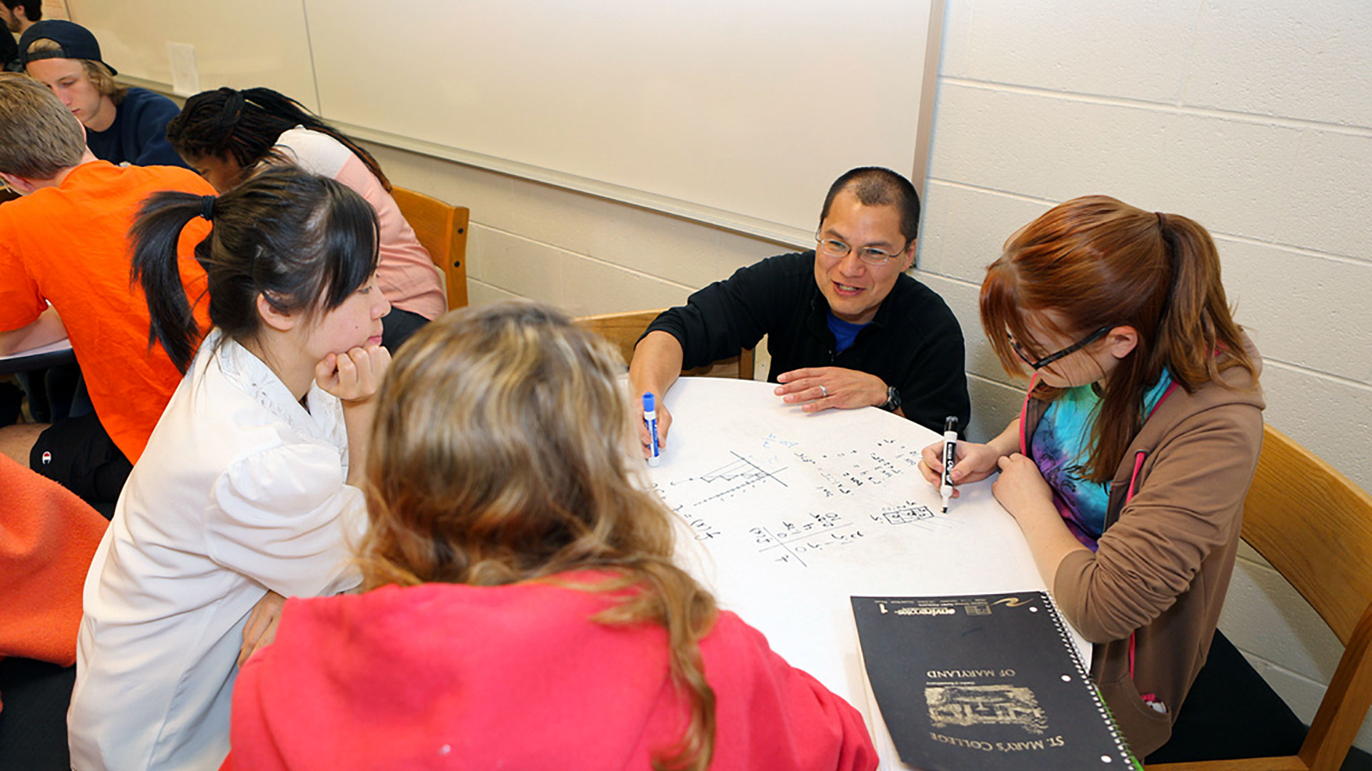 SMCM Math Program Professor David T. Kung works with students at round table