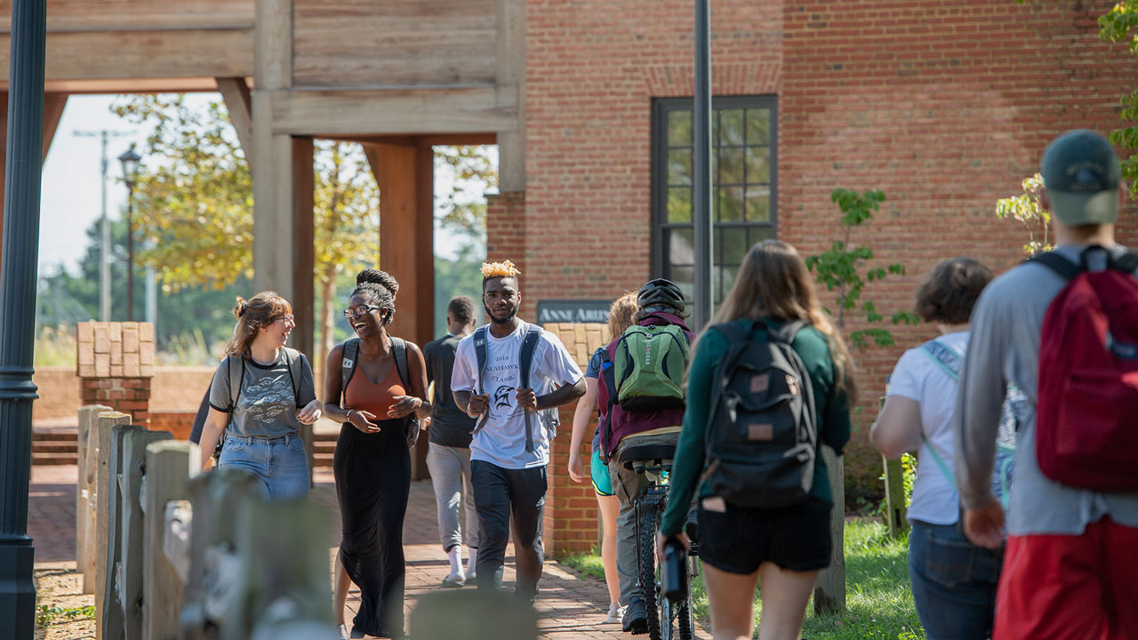 SMCM students walk down the path by Anne Arundel Hall