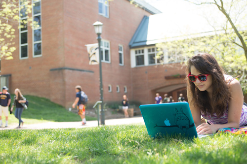 Female Student Studying Outside on the Lawn