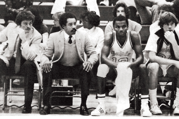 Donny Bryan sitting on the sidelines of a basketball game