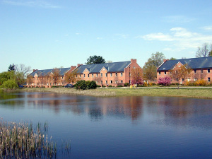 a row of brick townhouses overlooking a body of water