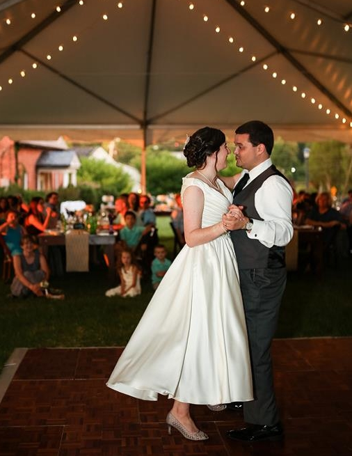A couple dances at a tented reception after a wedding at St. Mary's College of Maryland