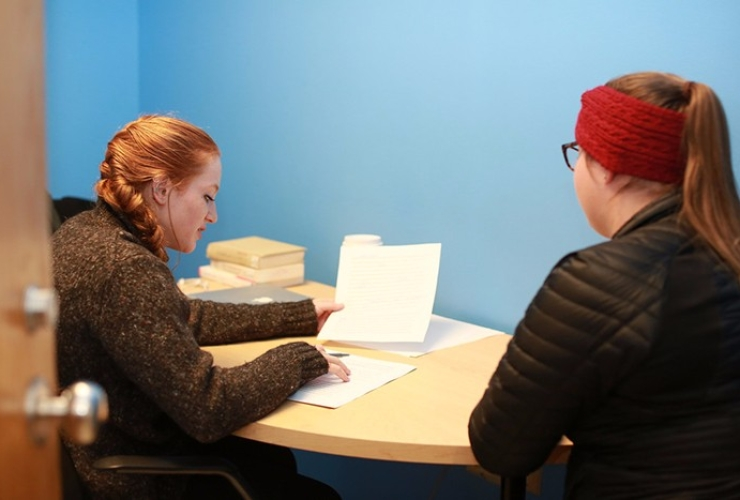 Hannah tutoring another student.